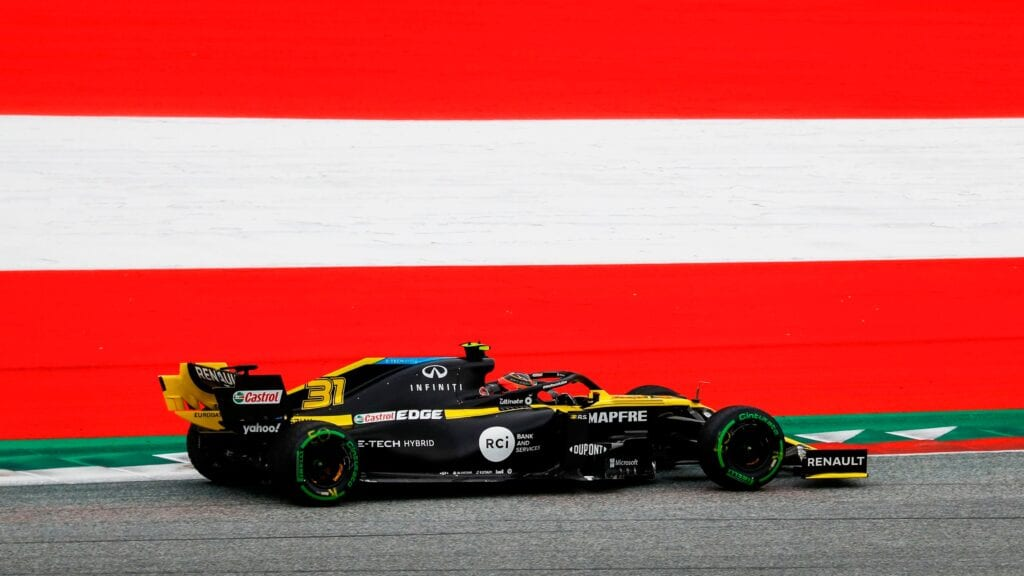 Mercedes drivers Lewis Hamilton and Valtteri Bottas topped the times in first practice for the Austrian Grand Prix, as the on-track action for Formula 1's 2020 season finally got underway.Seven months after the 2019 campaign concluded, the coronavirus-delayed new season began under cloudy skies at the Red Bull Ring, with little action taking place in the first third of the 90-minute session.Most cars were kept in their garages after the field completed the initial installation laps, although the McLaren drivers Carlos Sainz and Lando Norris, along with Bottas, set the early pace.But the trio joined the rest in the pits after 20 minutes as a wet track was declared following a light smattering of rain.Ferrari's Sebastian Vettel led the field back out for a few laps on the intermediates, but the drivers quickly concluded that the track was not wet enough to use the grooved rubber.Shortly after the session's first third had been completed, Hamilton set his first flying laps on the hard Pirelli rubber, improving on three successive laps to soon claim the top spot with a 1m06.994s.Racing Point's Sergio Perez looked set to depose Hamilton soon afterwards but his RP20 began smoking around his flying lap and he had to abandon his effort so the issue could be rectified.Hamilton continued to improve the best time, briefly interrupted by Lance Stroll before the Racing Point driver had his time deleted for a track limits infringement at the exit of the penultimate corner.A flurry of action in the middle of the session led to Sainz, Stroll and Renault's Daniel Ricciardo enjoying brief spells in first place, with Perez then taking the top spot as soon as he returned to the track to head a brief Racing Point 1-2 with 1m06.052s.But as the session approached the one-hour mark, the Mercedes cars returned to the fray after a chunk of time waiting in their garages, with Bottas bettering Perez's improved best of 1m05.773s to a 1m05.486s on the softs.Hamilton then used his own first effor